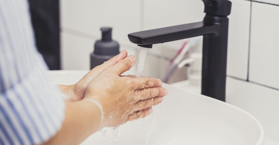 Woman washing her hands